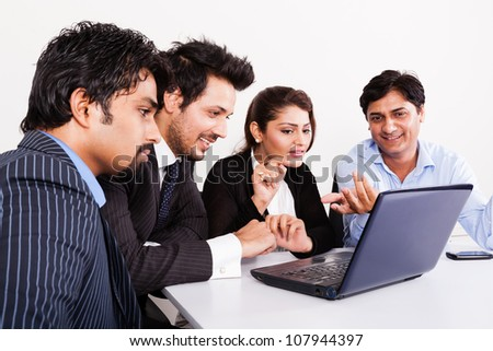 group of multi racial business people in meeting, Indian business woman in meeting with young businessmen.