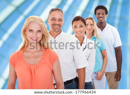 Group Of Multi-racial People Standing In A Row At Office