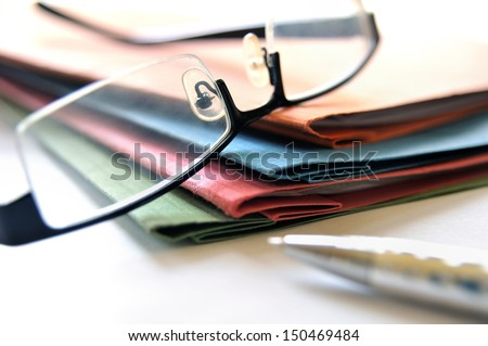 Group of multicolored office folders and glasses - stock photo