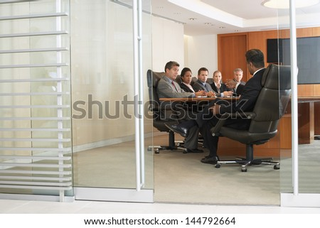 Group of multiethnic business people in office meeting - stock photo