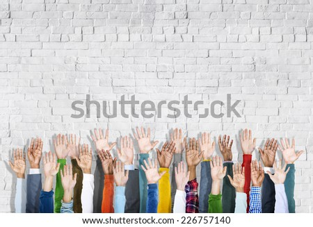 Group of Multiethnic Diverse Hands Raised - stock photo