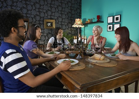 Group of multiethnic friends enjoying dinner party - stock photo