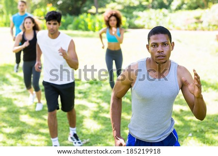 Group of multiethnic people running for fitness in the park - stock photo