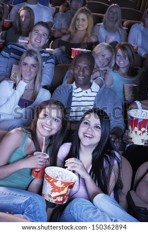 Group of multiethnic people watching film in movie theater - stock photo