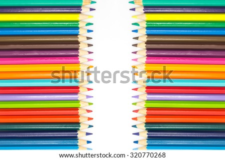 Group of multiple wooden colour pencils on white background - stock photo