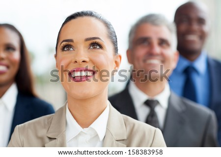 group of multiracial business people looking up - stock photo