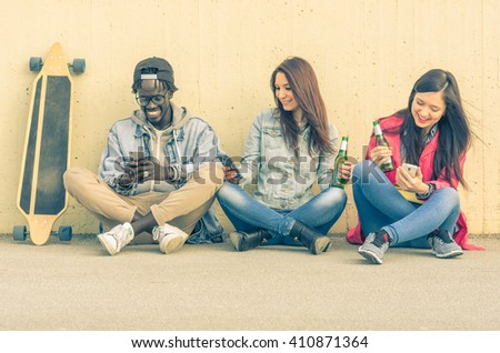 Group of multiracial people using their smartphone - black and caucasian people - concept about people, lifestyle and technology - stock photo