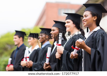 group of multiracial university graduates at graduation ceremony