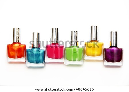 Group of nail polishes of different colors on white background