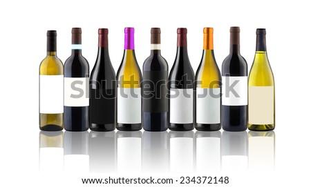 Group of nine wine bottles isolated on white - stock photo