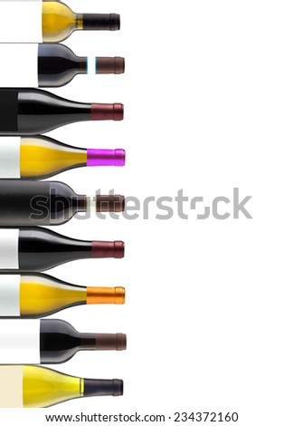 Group of nine wine bottles isolated on white with space for your logo or text - stock photo