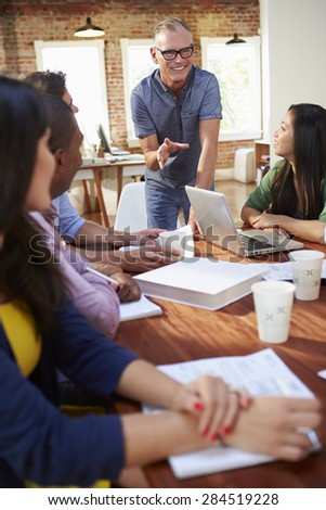 Group Of Office Workers Meeting To Discuss Ideas - stock photo