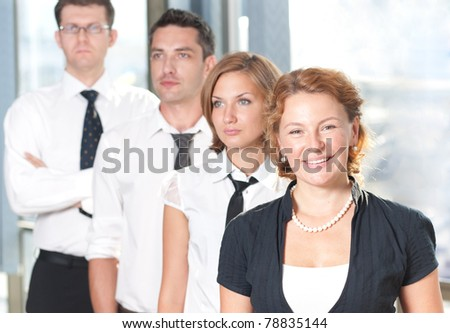 Group of office workers posing for camera - stock photo