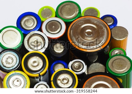 Group of Old AA, AAA and C Batteries in Closeup on White. Selective Focus.