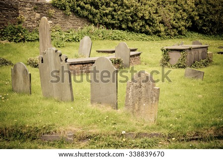 Group of old cemetary tombstones - stock photo