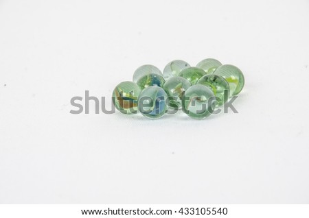 Group of old colorful marbles isolated on white - stock photo