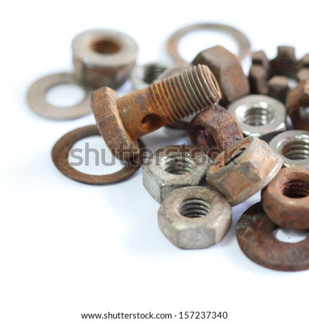 group of old rusty nuts and bolts isolated on white background