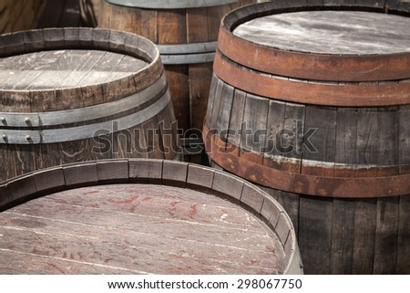 Group of old wooden barrels, selective focus on a foreground - stock photo