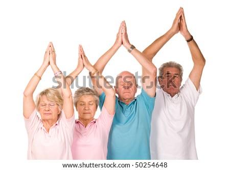 Group of older mature people doing yoga exercises, isolated on white background - stock photo