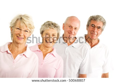 Group of older mature people having fun and smiling in the gym - stock photo