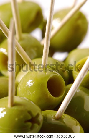 Group of olives and toothpicks. - stock photo