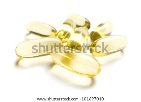 Group of Omega-3 capsules on white - stock photo