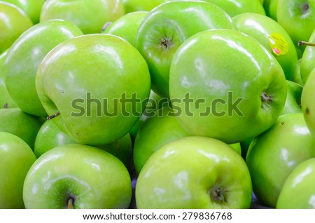 Group of organically grown Granny Smith apples in the farmer market at Puyallup, Washington, USA. A close up full frame of green apples. - stock photo