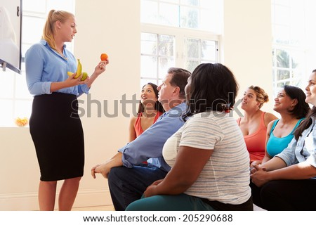 Group Of Overweight People Attending Diet Club - stock photo