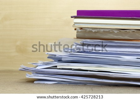 group of paper and book