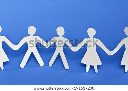 Group of paper chain people holding hands - stock photo
