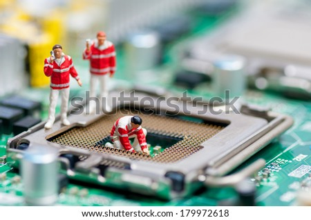 Group of paramedics recovering damaged CPU. Technology concept - stock photo