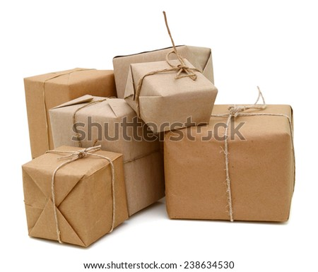 Group of parcels wrapped with brown paper and tied with string. Isolated on white background  - stock photo