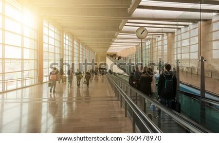 Group of passengers walking at airport - stock photo