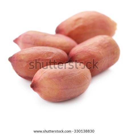 Group of peeled peanuts isolated on white background.