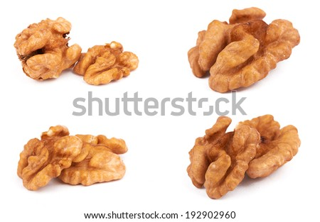 Group of peeled walnuts isolated on a white  - stock photo
