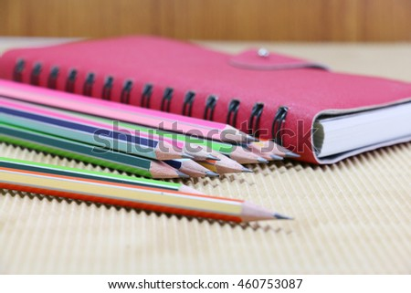 group of pencil and red note on wooden desk in office