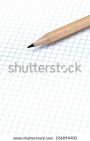 group of pencils on blue line grid sheet - stock photo