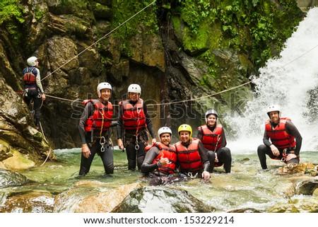 Group of peoaple having fun during a canyoning expedition in Llanganates National Park, Ecuador - stock photo