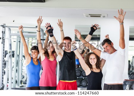 Group of People at Gym - stock photo