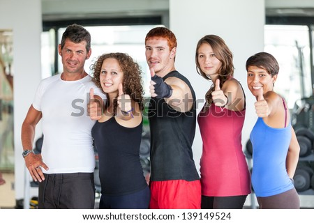 Group of People at Gym with Thumbs Up - stock photo
