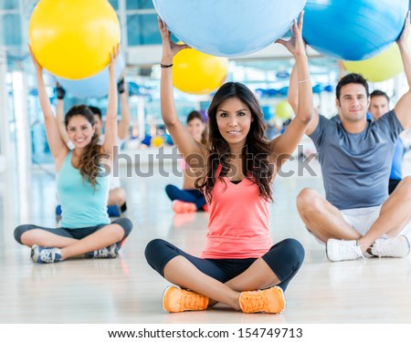 Group of people at the gym doing Pilates
