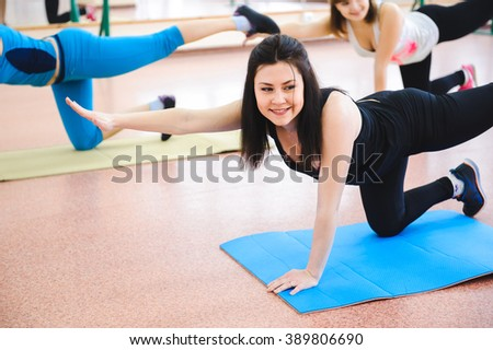 Group of people at the gym in a stretching class - stock photo