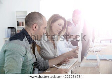 Group of people attending management training course - stock photo
