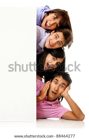 Group of people behind a banner looking surprised â?? isolated over white - stock photo
