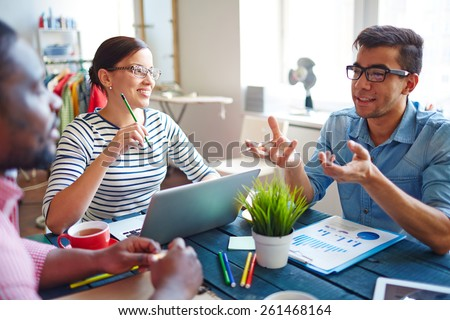 Group of people communicating in studio - stock photo