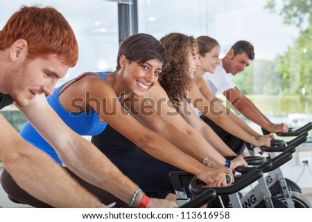 Group of People Cycling at Gym