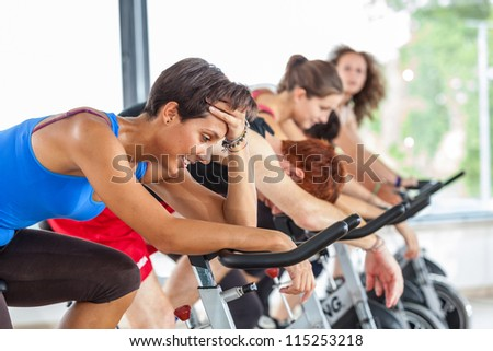 Group of People Cycling at Gym - stock photo