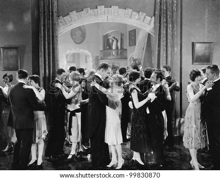Group of people dancing in a ballroom - stock photo