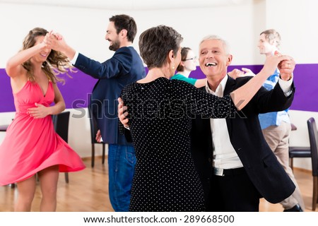 Group of people dancing in dance class having fun - stock photo