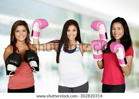 Group of people doing a kick boxing workout - stock photo